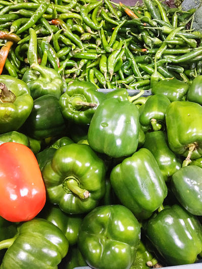 Close-up of green bell peppers for sale in market