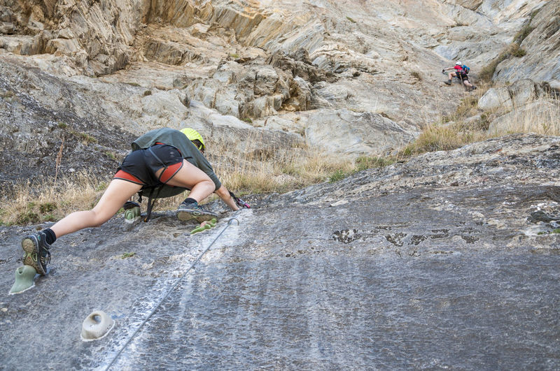 Via Ferrada Roc de Quer at Cnillo in Andorra Activity Adrenaline Adventure Cable Challenge Climbing Dangerous Exciting Extreme Sports Healthy Lifestyle Helmet Mountain Outdoors RISK Rock - Object Rock Climbing Rock Face Rocks Safe Secured Sport Via Ferrata Vitality Young Adult Young Women