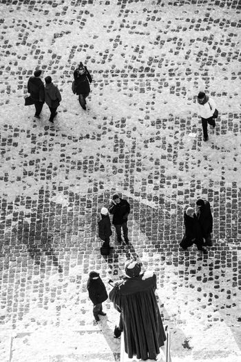 High angle view of people walking on snow covered land