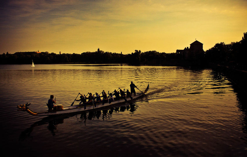 Hometown moments Athlete Cooperation Coordination Dragonboat Hungary Lake Leisure Activity Medium Group Of People Motion Nature Nautical Vessel Outdoors Reflection Rowboat Rowing Silhouette Sport Sport Rowing Summer Sun Goes Down Sunset Sunset_collection Teamwork Transportation Vitality The Great Outdoors - 2017 EyeEm Awards