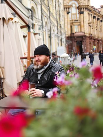 One Person Real People Flower Flowering Plant Lifestyles Plant Men Males  Selective Focus Architecture Mid Adult Front View Mid Adult Men Adult Beard Waist Up Day Clothing Outdoors Warm Clothing