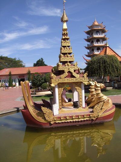 Ceremonial Boat & Pagoda at Chinese Temple Blue Sky White Clouds Boat Ceremonial Boat Chinese Culture Chinese Temple Composition Full Frame Gold Colour Maymyo Myanmar No People Outdoor Photography Pagoda Place Of Prayer Place Of Worship Place Of Worship Reflection In The Water Religion Spirituality Sunlight Tourist Attraction  Tourist Destination Travel Destinations Trees Water