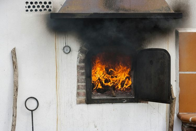 Smokes coming out from wood burning stove