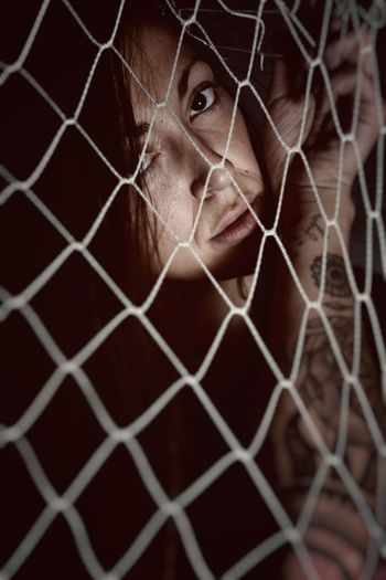 Portrait Of Young Woman Seen Through Netting