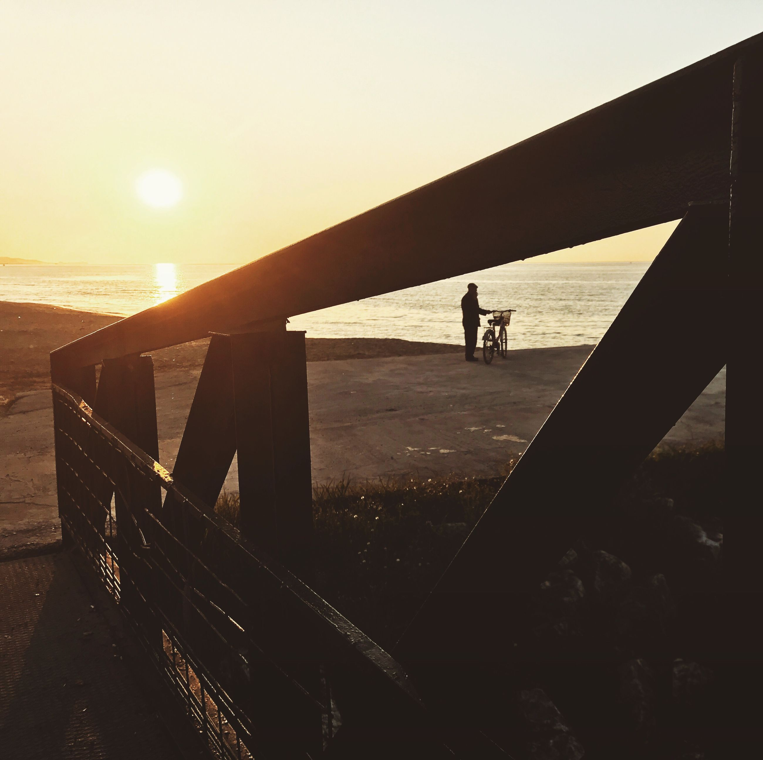 leisure activity, real people, lifestyles, sunset, silhouette, sunlight, railing, full length, men, outdoors, skill, sky, one person, sea, friendship, day, people, adult