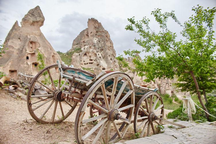 Old rusty wheel on rock