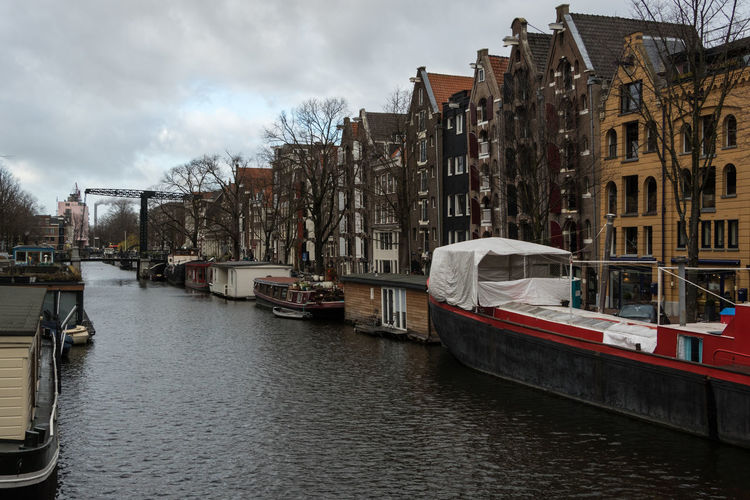 Amsterdam, The Netherlands Amsterdam The Netherlands Nederland Architecture Building Exterior Built Structure Building City Transportation Outdoors Nautical Vessel Water Mode Of Transportation Sky Cloud - Sky Canal Waterfront No People Residential District Travel Day Passenger Craft Cityscape Sailboat