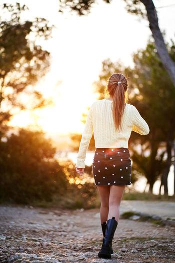 Rear view of woman walking in park