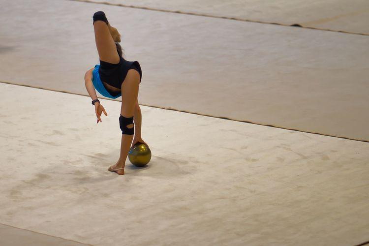 High angle view of woman climbing on floor