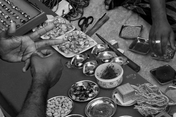 the street gemstone hawker #photography #Bangladesh #streetphotography #chittagong #life #blackandwhite #gemstone #asia My Best Photo Human Hand Women Table High Angle View Plate Close-up