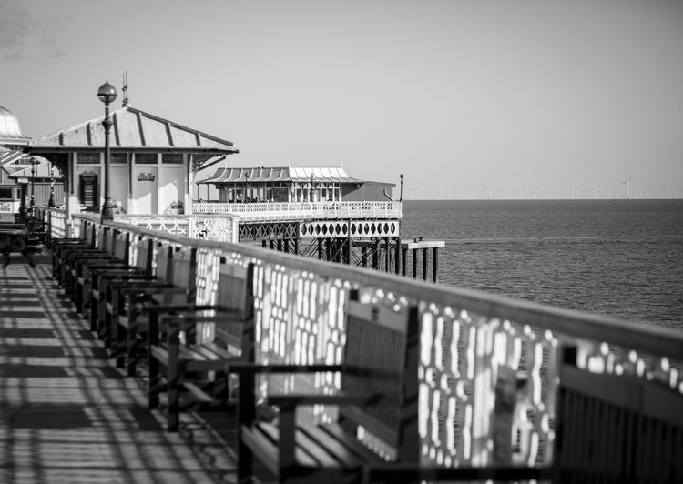 Llandudno pier north wales Llandudno Pier Water Sea Architecture Railing Sky Built Structure Horizon Over Water Horizon Pier Nature Day Building Exterior No People Outdoors Clear Sky Tranquil Scene Tranquility Travel Destinations Safety Black And White Wales UK
