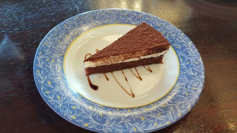 High Angle View Of Tiramisu Cake Slice In Plate