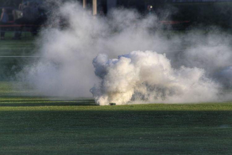 Smoke emitting from volcanic on field