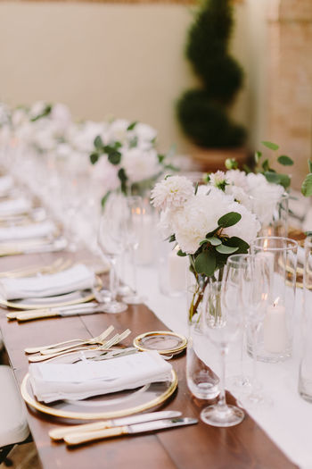Place setting on dining table during wedding ceremony