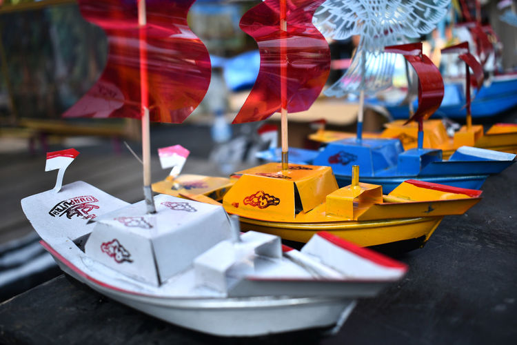 Traditional Toy Boats No People Paper Boat Large Group Of Objects Retail  Day For Sale Still Life Focus On Foreground Selective Focus Origami Creativity Toy Paper Close-up Flag Representation Indoors  Market Choice Table Retail Display Toys INDONESIA Central Java Blue
