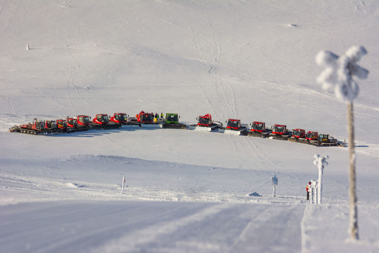 High angle view of vehicles parked on snow covered landscape