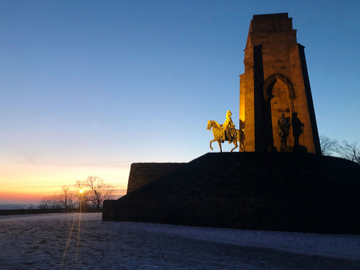 Statue of historical building at sunset