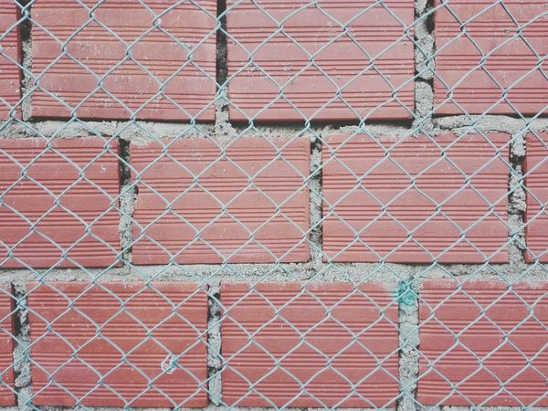 Brickwall Chainlink Fence Full Frame Metal Backgrounds Protection Built Structure Close-up Building Exterior Pattern Brick Brick Wall Bricks Red Color Red Brick Wall Red Bricks Day No People Huawei P8 Lite Huawei Shots
