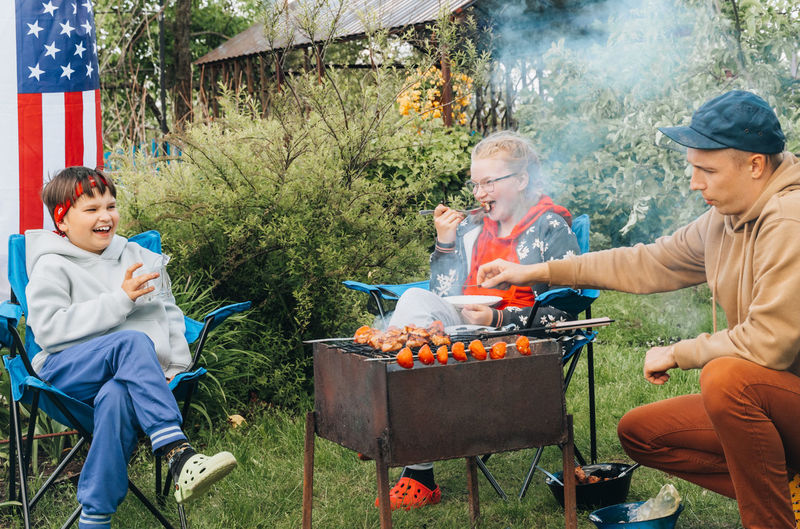 People sitting on barbecue grill