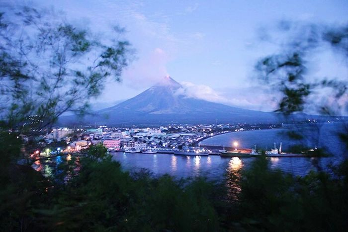 Mayon Volcano Daraga, Albay Philippines Volcanic Landscape Leisure Activity Cityscape Albay, Philippines No People Travel Destinations Outdoorphotography Mountain Reflection Illuminated Cityscape Architecture Cloud - Sky Water City River Nightlife EyeEmNewHere