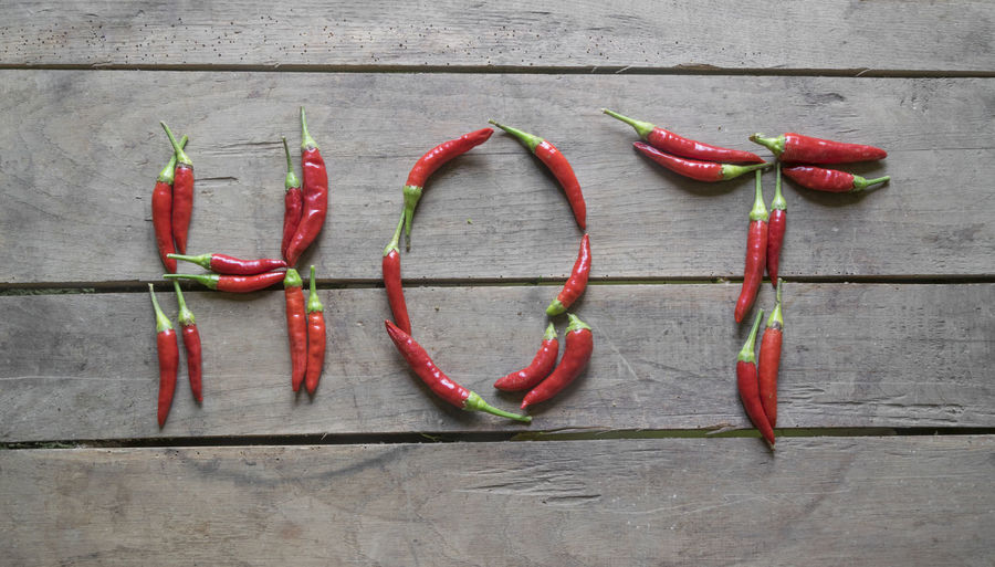 Red chili peppers on wood