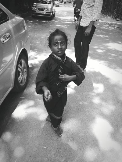 Kids beg on streets, is it poverty or she reaally utilizing money for serving god ? Thats india Myopinion India People Blackandwhite Kids Relegion PhonePhotography Streetphotography Expression Photos That Will Restore Your Faith In Humanity Picturing Individuality