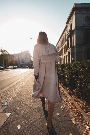 Rear View One Person Real People Architecture Full Length Walking Building Exterior Women Lifestyles Standing Built Structure City Adult Nature Leisure Activity Young Adult Day Sky Casual Clothing Outdoors Hairstyle Overcoat Streetwise Photography
