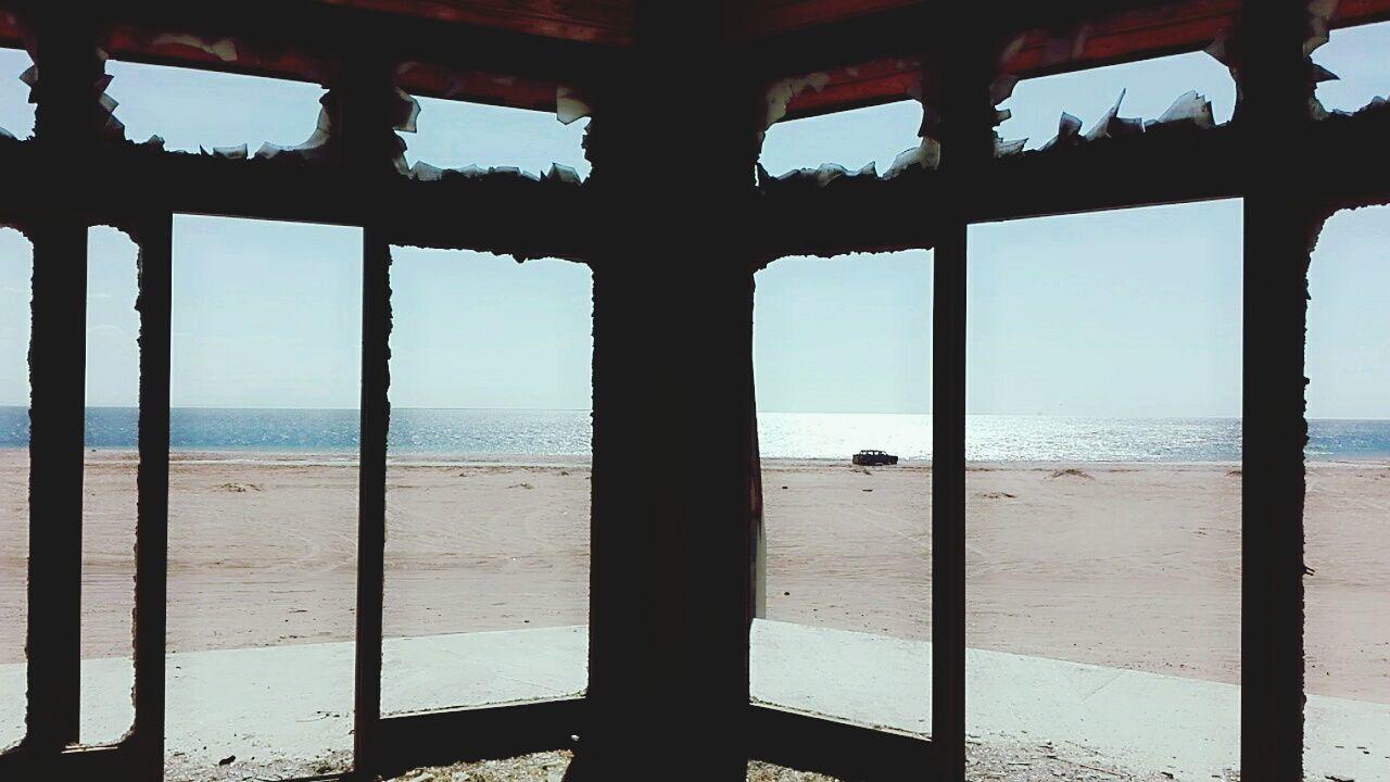 sea, water, window, sky, nature, horizon over water, beach, scenics, day, tranquil scene, beauty in nature, no people, indoors