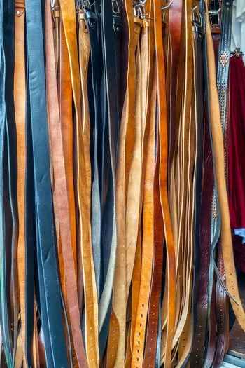 Leather belts for sale in market EyeEmNewHere Leather Sale Belts Boutique Choice Clothing Coathanger Consumerism Fashion For Sale Garment Hanging In A Row Indoors  Large Group Of Objects Leather Belt Market Market Stall Multi Colored No People Rack Retail  Retail Display Sale Shopping Side By Side Store Textile Variation