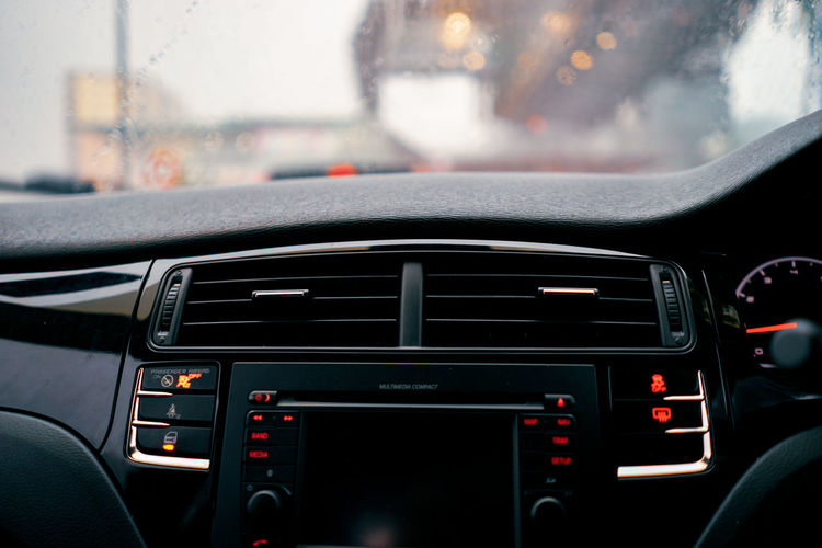 Car Car Interior Close-up Control Panel Dashboard Focus On Foreground Glass - Material Indoors  Land Vehicle Mode Of Transportation Motor Vehicle No People Rain RainDrop Rainy Season Road Trip Steering Wheel Transparent Transportation Travel Vehicle Interior Window Windshield The Still Life Photographer - 2018 EyeEm Awards