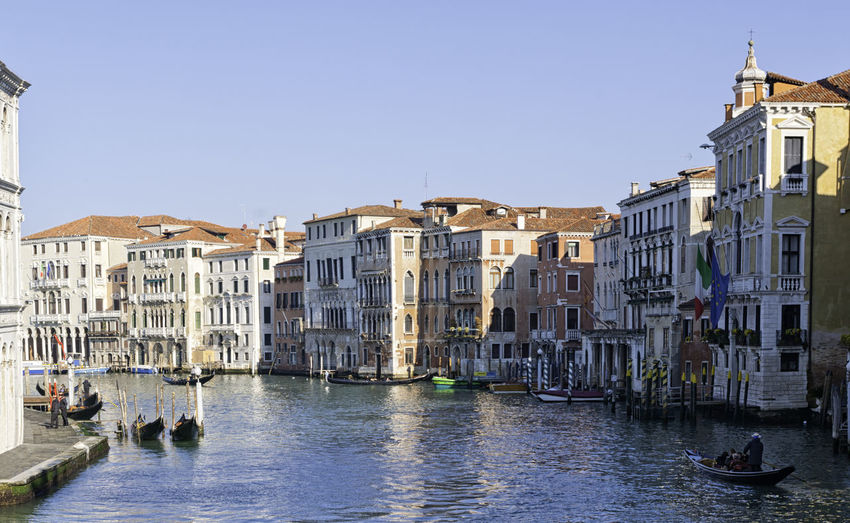 View of the famous Grand Canal in Venice, Italy. Historic Venetian canal in daylight with boats and old traditional buildings on the side Canoe Channel Gondola Romantic Venetian Architecture Boat Bridge Building Canal City Daylight Dock Grand Iconic Italian Italy Old Rialto Traditional Unesco Urban Veneto Venice Water