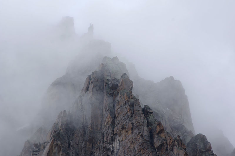 Panoramic View Of Mountains In Foggy Weather