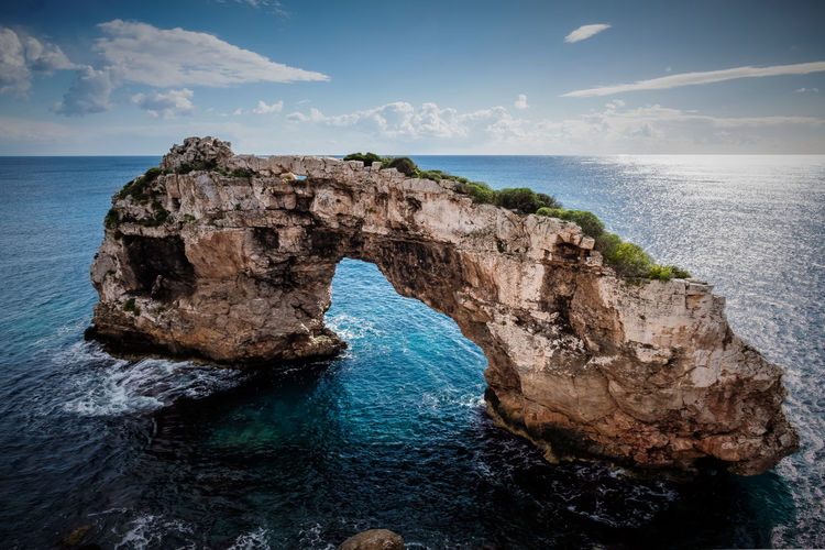 Mallorca Arch Beauty In Nature Blue Cliff Day Horizon Over Water Idyllic Natural Arch Nature No People Outdoors Rock - Object Rock Formation Scenics Sea Sky Tranquil Scene Tranquility Water Waterfront