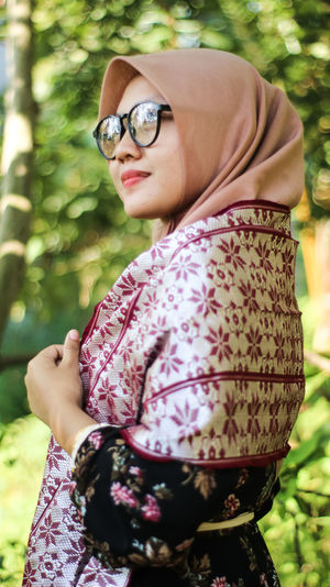 Woman wearing hijab while standing in park