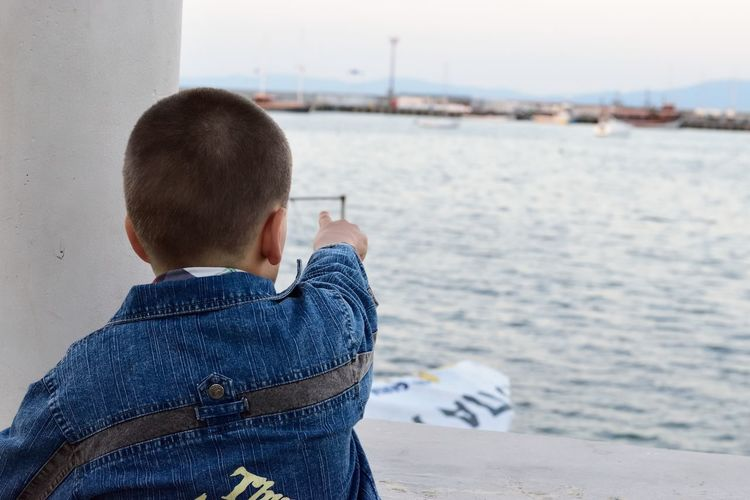 Casual Clothing Childhood Close-up Day Focus On Foreground Human Hand Leisure Activity Lifestyles Men Nature Nautical Vessel One Person Outdoors People Pointing Real People Rear View Sea Technology Watching Water Wireless Technology The Week On EyeEm Stories From The City