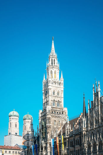 Architecture Blue Building Exterior Built Structure Capital Cities  City City Life Clear Sky Culture Day Famous Place High Section Low Angle View Marienplatz No People Outdoors Tall - High Tourism Travel Destinations
