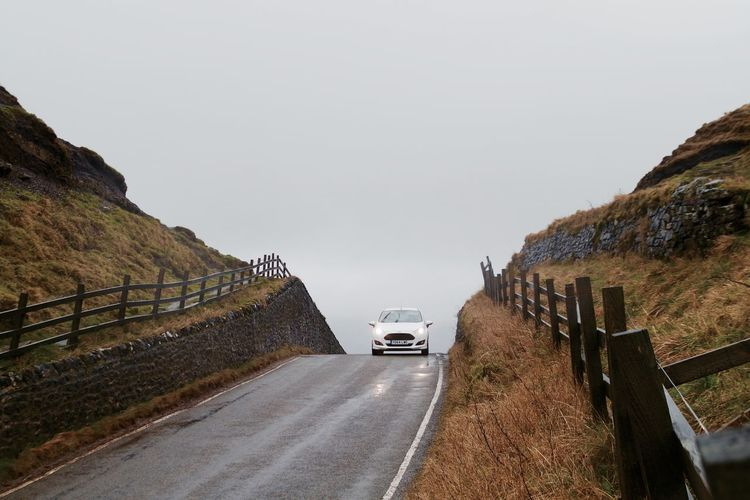 Car on road against clear sky