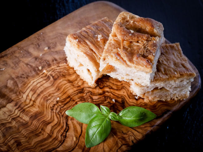Basil Ciccioli Bread Brown Close-up Focaccia Food Food And Drink Freshness Green Color Healthy Eating Herb High Angle View Indoors  Leaf No People Plant Part Ready-to-eat SLICE Snack Still Life Wellbeing Wood - Material