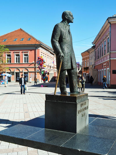 European Cities Novi Sad Serbia Eastern Europe Balkans Europe Outdoors Sunlight And Shadow Cityscape City Life Public Places Building Exterior Architecture Built Structure Day Building Street Photography City Sculpture Human Representation Statue Male Likeness History Memorial Footpath Incidental People Pedestrian Zone