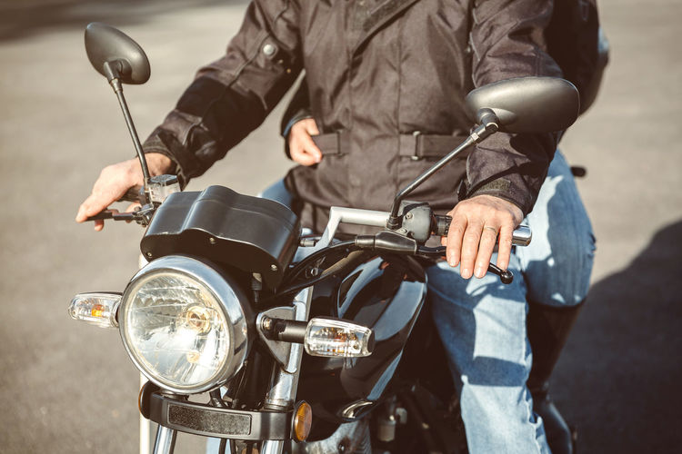Midsection Of Couple On Motorbike