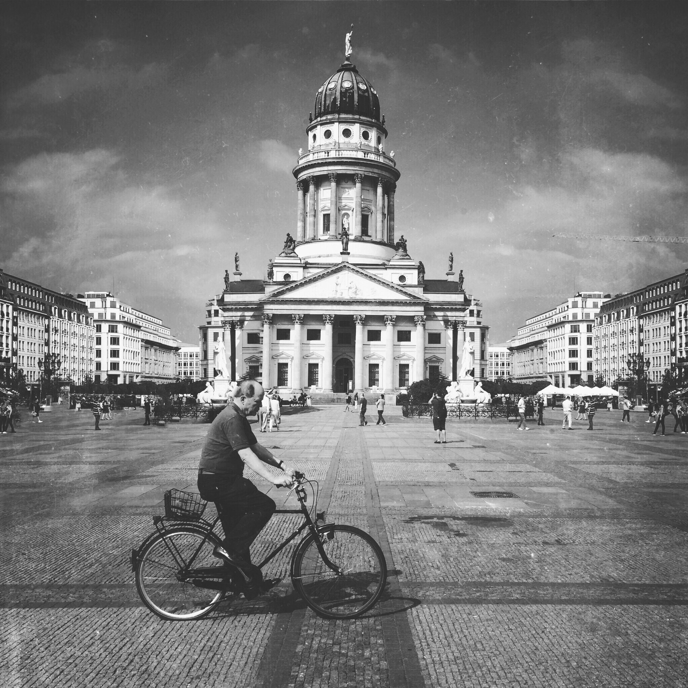 building exterior, architecture, built structure, sky, bicycle, men, street, transportation, city, land vehicle, walking, cloud - sky, lifestyles, person, mode of transport, travel, incidental people, city life, leisure activity