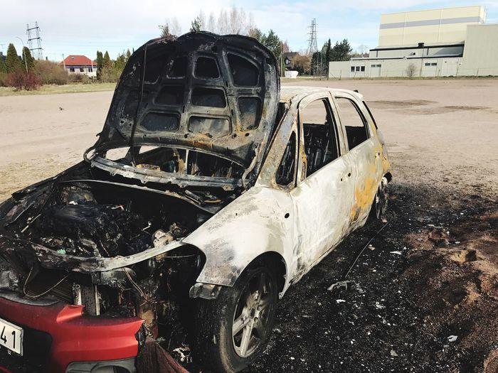 Burned car Burned Car EyeEm Selects Transportation Mode Of Transportation Day Nature Land Vehicle Land Damaged Motor Vehicle Abandoned The Photojournalist - 2018 EyeEm Awards