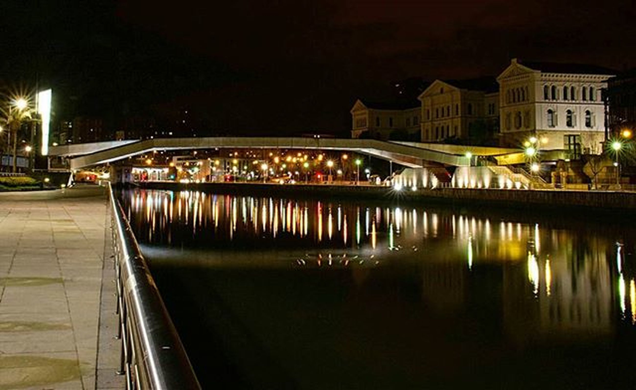 illuminated, night, architecture, built structure, water, building exterior, reflection, city, river, waterfront, street light, lighting equipment, bridge - man made structure, city life, connection, transportation, canal, outdoors, sky, bridge