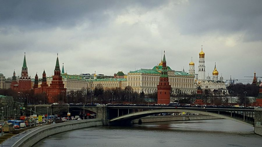 Bridge - Man Made Structure Cityscape Travel Destinations Architecture Politics And Government City River Government Clock Tower Ferris Wheel Urban Skyline Outdoors Sky People Day Russia Moscow Kremlin Kreml Moskau Kremlin Architecture Russia Kreml