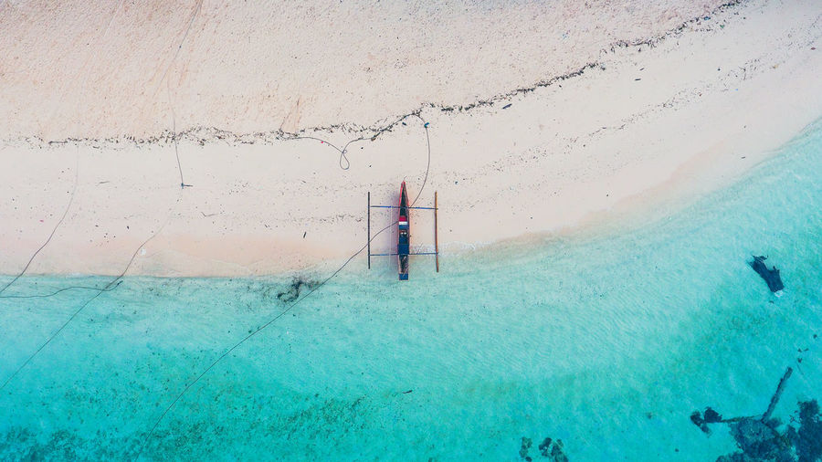 High Angle View Of Outrigger Moored On Shore At Beach