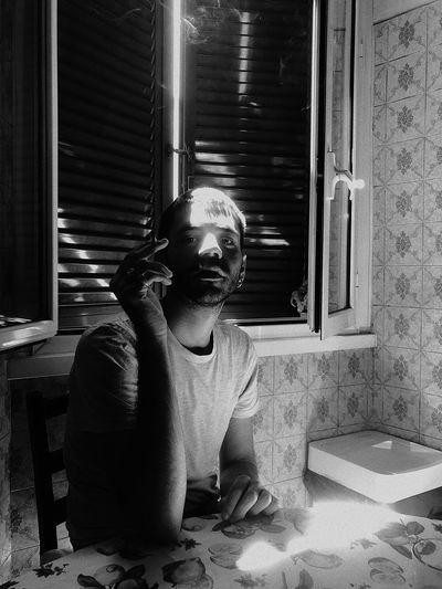 Portrait of man holding bidi in home