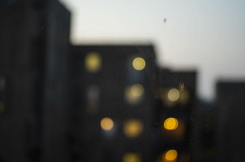 Defocused image of city seen through glass window