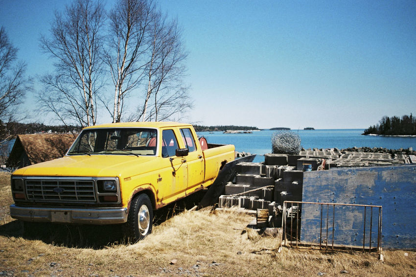 A Collection of photographs taken during the spring in Thunder Bay. Northern Ontario, Canada. Abandoned Bare Tree Blue Canada Clear Sky Colour Day Fujifilm Lake Land Vehicle Mode Of Transport No People Northern Ontario Old Car Ontario Outdoors Provincial Park Sky Sleeping Giant Spring Superia Thunder Bay Transportation Tree Yellow