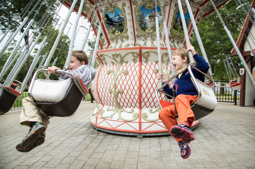 Amusement Park Amusement Park Ride Arts Culture And Entertainment Boys Carousel Childhood Day Enjoyment Ferris Wheel Full Length Fun Leisure Activity Lifestyles Merry-go-round Outdoors People Playing Real People Togetherness Two People