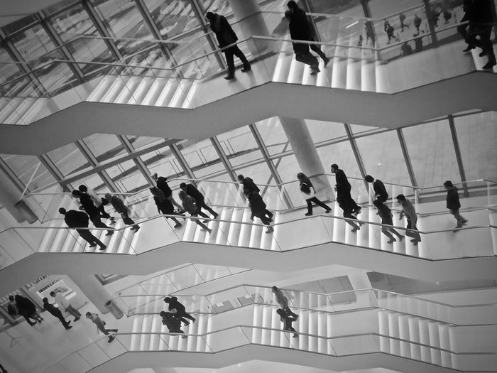 High angle view of people on staircase in building